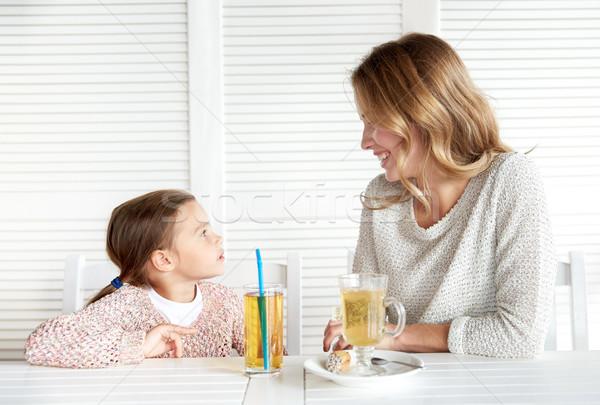happy family having dinner at restaurant or cafe Stock photo © dolgachov