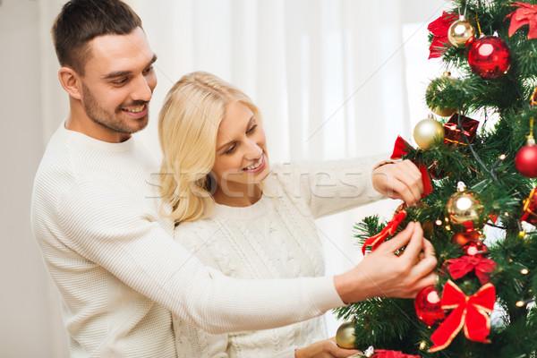 Boldog pár karácsonyfa otthon család karácsony Stock fotó © dolgachov