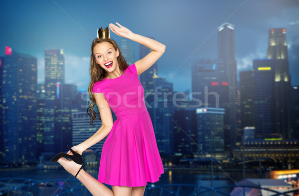 happy young woman in crown over night city Stock photo © dolgachov