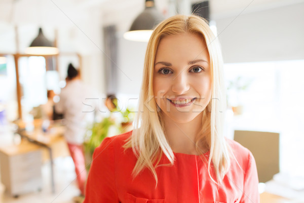 Stock photo: happy creative woman at office or bureau