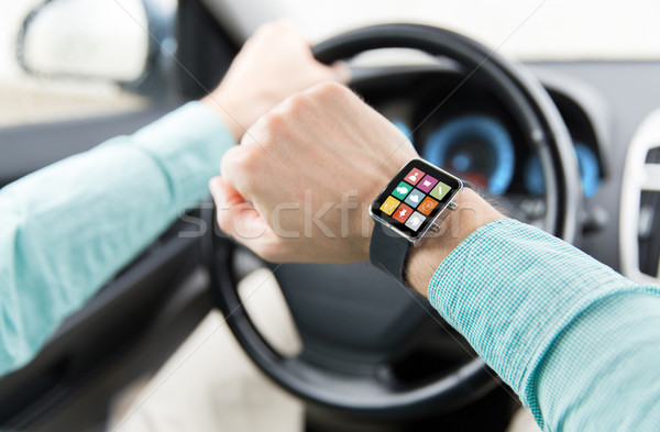close up of man with app on smartwatch driving car Stock photo © dolgachov