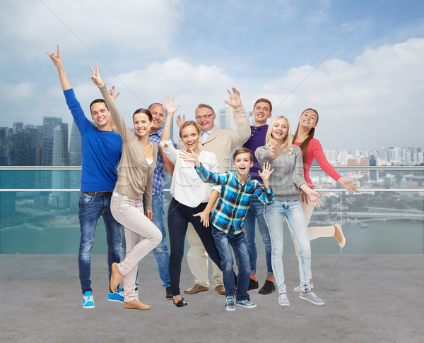 group of smiling people having fun Stock photo © dolgachov