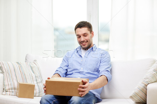 happy man with cardboard boxes or parcels at home Stock photo © dolgachov