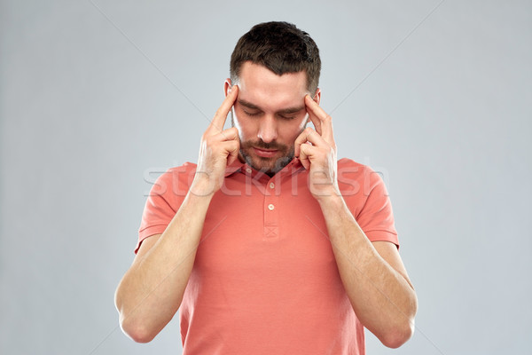 Stock photo: man suffering from head ache or thinking