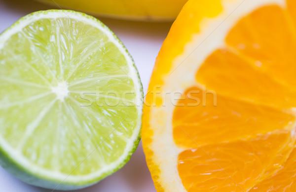 Fraîches juteuse orange chaux Photo stock © dolgachov