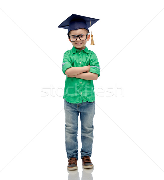 happy boy in bachelor hat or mortarboard Stock photo © dolgachov