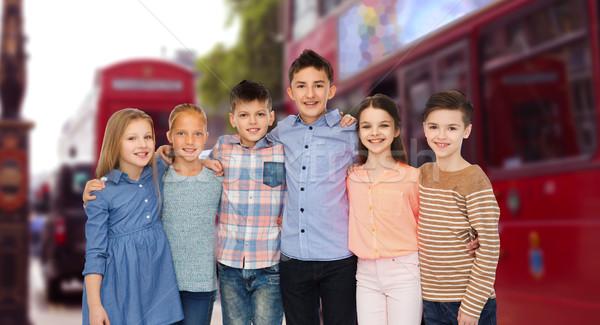 happy smiling children hugging over london city Stock photo © dolgachov