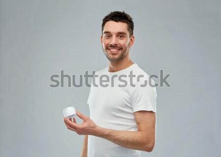 счастливым молодым человеком кремом лице серый Сток-фото © dolgachov