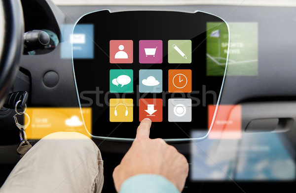 close up of hand and menu icons on car computer Stock photo © dolgachov