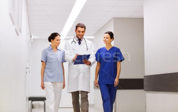 group of medics at hospital with clipboard Stock photo © dolgachov