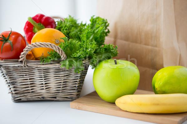 basket of fresh friuts and vegetables at kitchen Stock photo © dolgachov