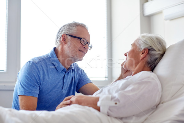 senior couple meeting at hospital ward Stock photo © dolgachov