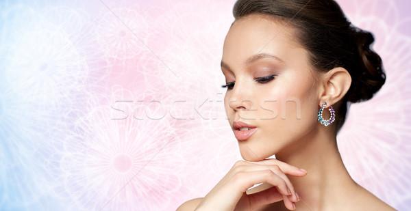 Belle femme visage boucle beauté bijoux Photo stock © dolgachov