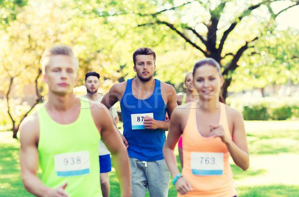 Genç yarış rozet sayılar uygunluk spor Stok fotoğraf © dolgachov
