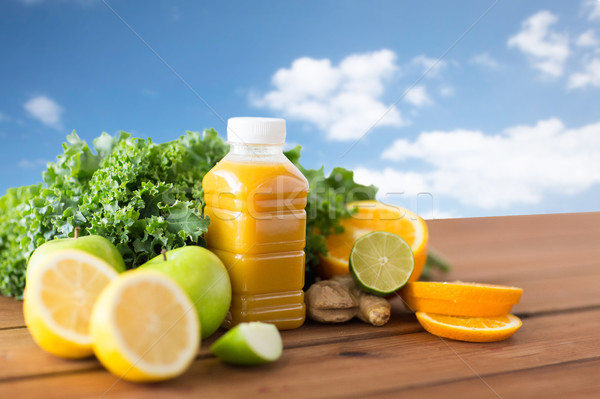 bottle with orange juice, fruits and vegetables Stock photo © dolgachov