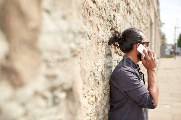 close up of man calling on smartphone in city Stock photo © dolgachov