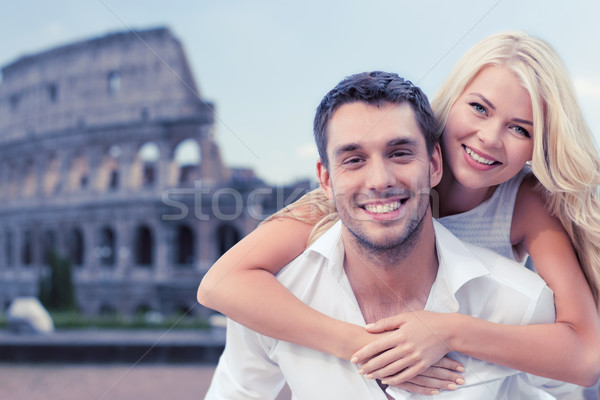 happy couple hugging over coliseum Stock photo © dolgachov