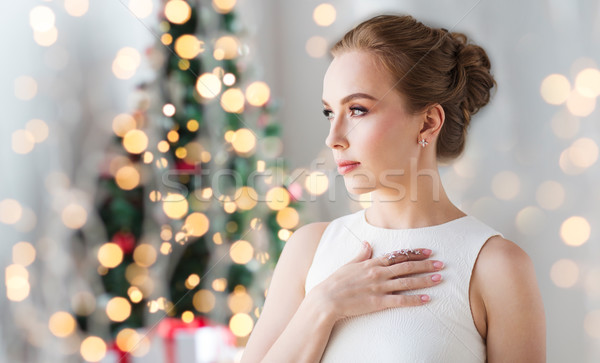 woman wearing diamond jewelry for christmas Stock photo © dolgachov