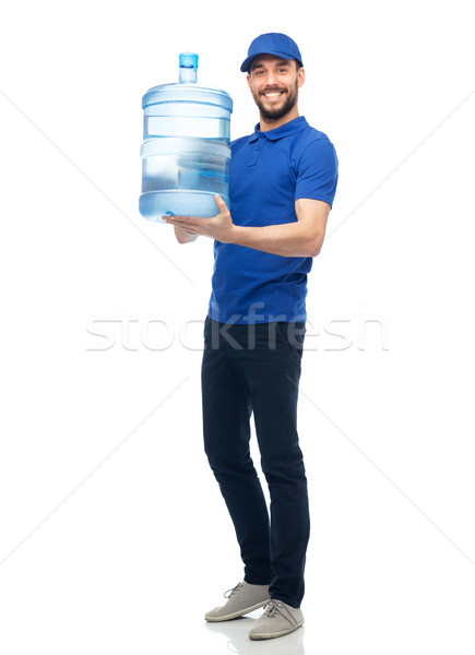 Stock photo: happy delivery man with bottle of water