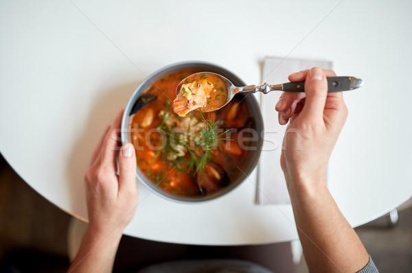 woman eating seafood soup at restaurant Stock photo © dolgachov
