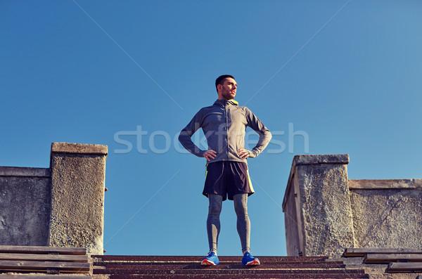 Boldog férfi stadion lépcső fitnessz sport Stock fotó © dolgachov