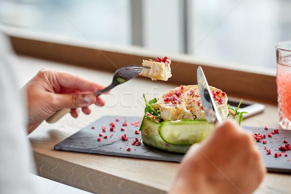 woman eating goat cheese salad at restaurant Stock photo © dolgachov