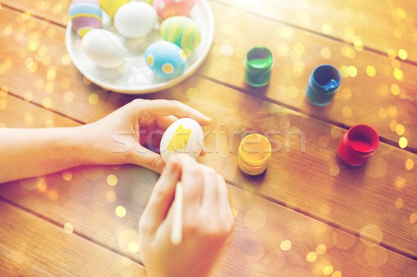 close up of woman hands coloring easter eggs Stock photo © dolgachov