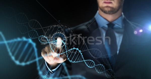 Imprenditore virtuale dna proiezione uomini d'affari scienza Foto d'archivio © dolgachov