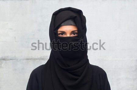 muslim woman in hijab over gray background Stock photo © dolgachov