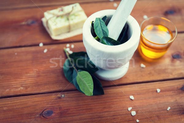 close up of mortar with leaves on wood Stock photo © dolgachov