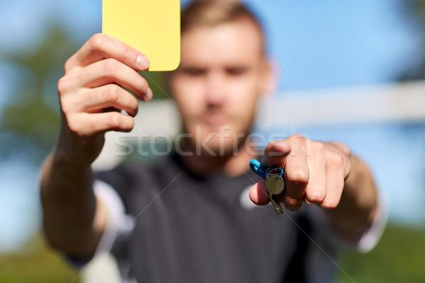 Arbitro campo di calcio giallo carta sport Foto d'archivio © dolgachov