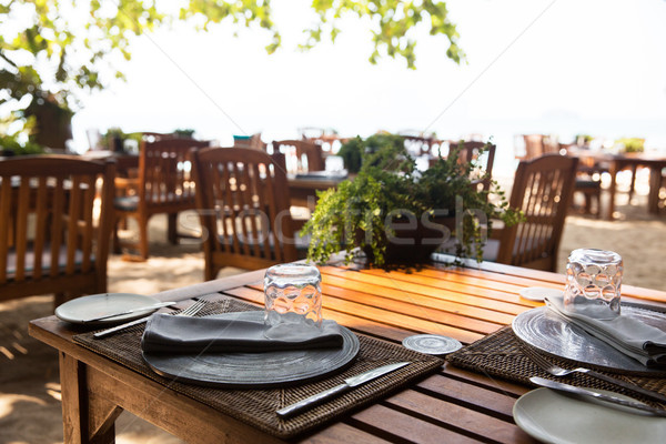served table at open-air restaurant on beach Stock photo © dolgachov