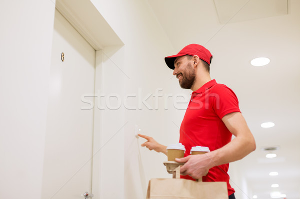 delivery man with coffee and food ringing doorbell Stock photo © dolgachov