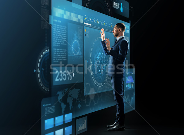 businessman with virtual screens projection Stock photo © dolgachov