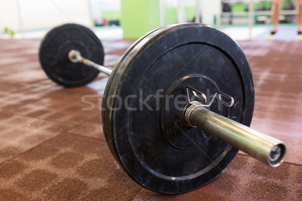 barbell on floor in gym Stock photo © dolgachov