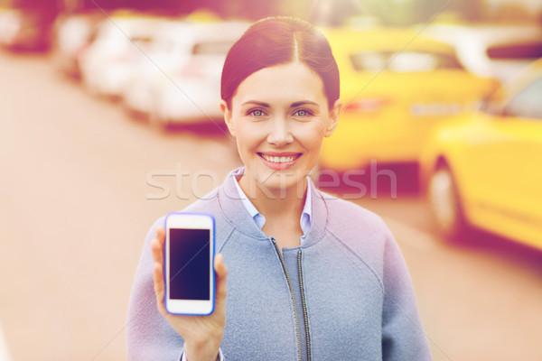 Mujer sonriente taxi ciudad viaje Foto stock © dolgachov
