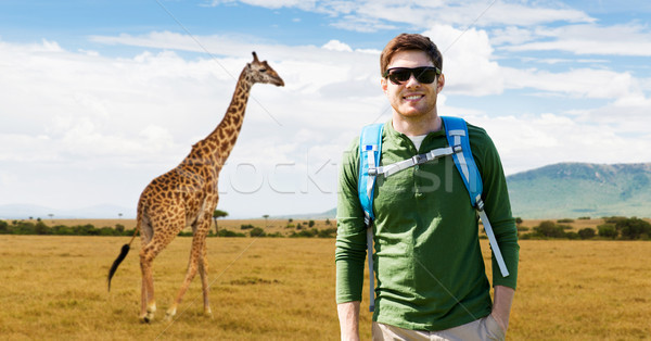 happy young man with backpack traveling in africa Stock photo © dolgachov