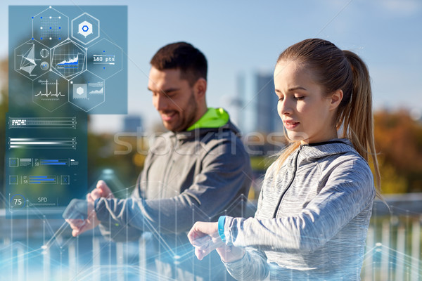 couple with heart-rate trackers training outdoors Stock photo © dolgachov