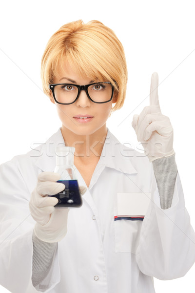 lab worker holding up test tube Stock photo © dolgachov