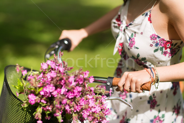 close up of woman riding fixie bicycle outdoors Stock photo © dolgachov
