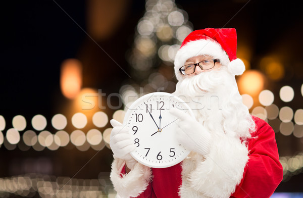 santa claus with clock pointing finger to twelve Stock photo © dolgachov