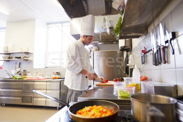 male chef cooking food at restaurant kitchen Stock photo © dolgachov