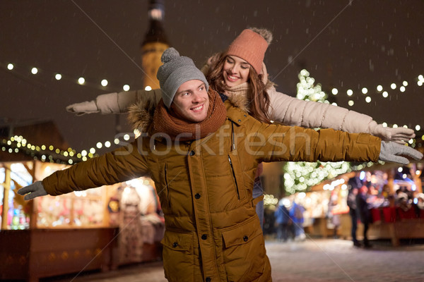 happy couple having fun at christmas market Stock photo © dolgachov