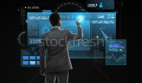 businessman working with virtual reality screens Stock photo © dolgachov