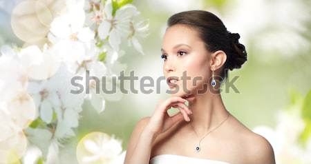 happy woman smelling flowers at home Stock photo © dolgachov