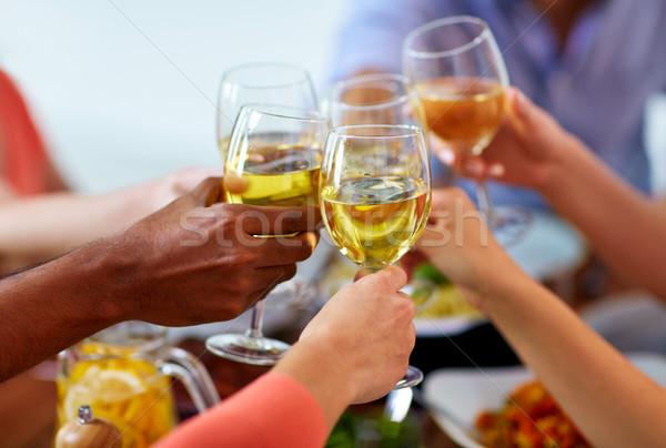 hands clinking wine glasses Stock photo © dolgachov