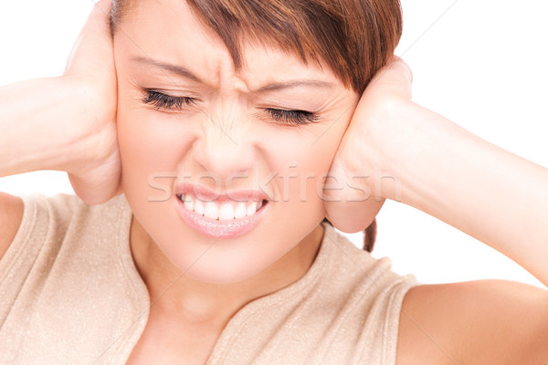 unhappy woman with hands on ears Stock photo © dolgachov