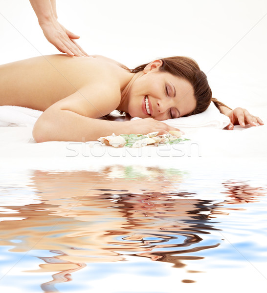 happy massage on white sand Stock photo © dolgachov