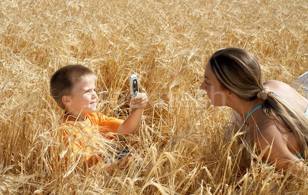 Kép anya gyerek mobiltelefon nő arc Stock fotó © dolgachov