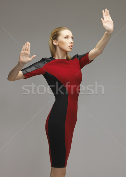 woman working with something imaginary Stock photo © dolgachov